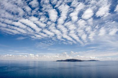 Clouds over Lake Titicaca and Taquile Island, in the Distance-Jonathan Irish-Photographic Print