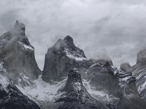 Clouds Over Snowcapped Mountains