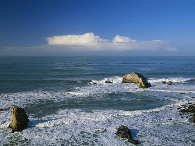 Clouds over the Pacific Ocean and Surf Spilling onto Shell Beach-Marc Moritsch-Photographic Print