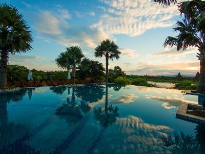 Clouds reflected in the infinity pool at sunrise, Aureum Palace Hotel, Bagan, Mandalay Region, M...--Photographic Print