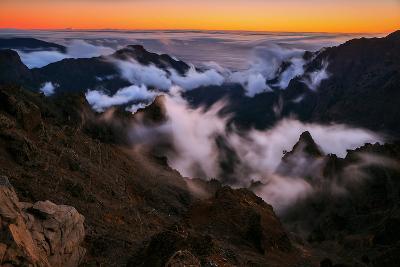 Clouds Roll over the Peaks at Caldera De Taburiente at Sunset-Babak Tafreshi-Photographic Print