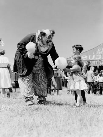 https://imgc.artprintimages.com/img/print/clown-handing-cotton-candy-to-children-outside-circus-tent_u-l-q10brqo0.jpg?p=0