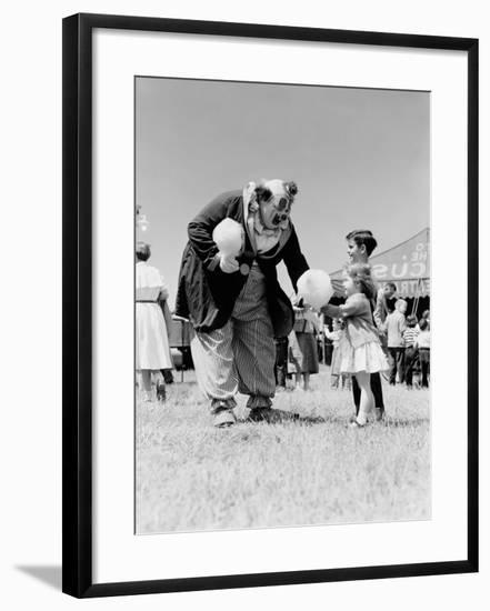 Clown Handing Cotton Candy To Children Outside Circus Tent-H. Armstrong Roberts-Framed Photographic Print