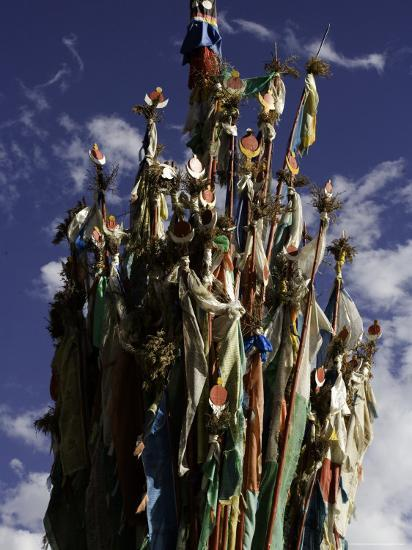 Cluster of Tibetan Prayer Flags against a Blue Sky with Clouds, Qinghai, China-David Evans-Photographic Print