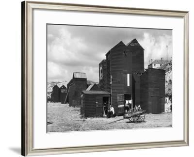 Clustered on the Shingle of the Old Town of Hastings Sussex are These Tall Black Huts-Fred Musto-Framed Photographic Print