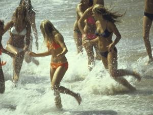 Bikini Clad Teens Frolicking in Surf at Beach by Co Rentmeester