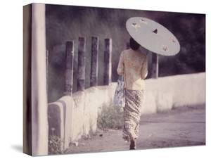 Indonesian Woman with a Parasol by Co Rentmeester