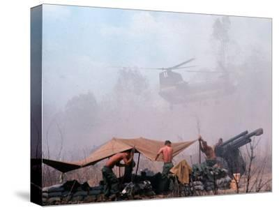 Shirtless American Soldiers of 1st Batt, Erect Canopy over a Sandbagged Position in Vietnam War