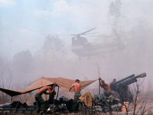 Shirtless American Soldiers of 1st Batt, Erect Canopy over a Sandbagged Position in Vietnam War by Co Rentmeester