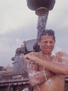 Soldier of the 11th Armored Regiment in Vietnam Taking a Shower by Co Rentmeester