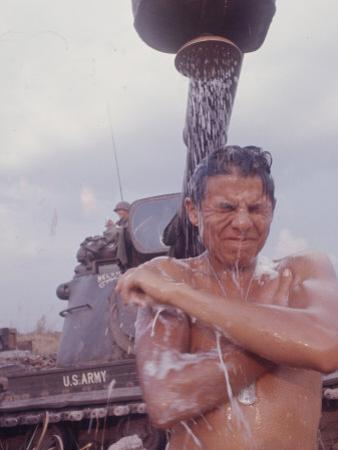 Soldier of the 11th Armored Regiment in Vietnam Taking a Shower