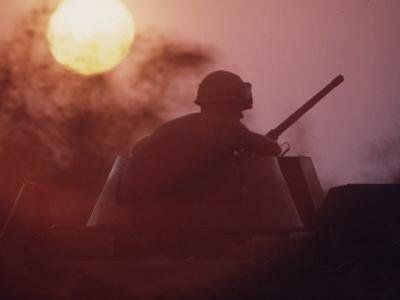 Soldier of the 11th Armored Regiment on a Tank in the Sunset. Vietnam