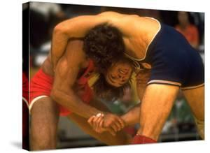 Wrestlers Wayne Wells and Ali Demirtas in Action at the Summer Olympics by Co Rentmeester