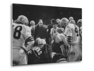 Coach Paul Brown Speaking to the Cleveland Browns Football Team from the Middle of the Huddle