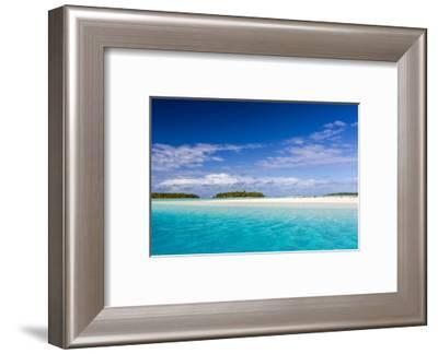 Coconut palm trees line the beach on One Foot Island, Aitutaki, Cook Islands, South Pacific Islands-Michael Nolan-Framed Photographic Print