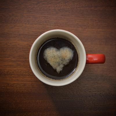 Coffee Cup with Crema Resembling a Heart Shape-David Malan-Photographic Print