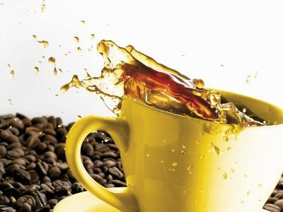 Coffee Spilling Out of a Cup-Dieter Heinemann-Photographic Print