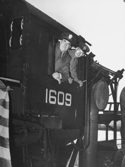 Col. Ryan and Major General Mcmullen Looking Out the Cab of a New Locomotive--Photographic Print