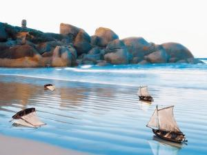 Toy Boats on Rocky Beach by Colin Anderson