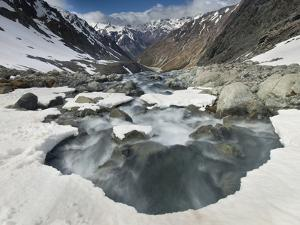 White River Rapids Flow over Spring Snow Bank, Arthur's Pass National Park, Canterbury, New Zealand by Colin Monteath/Minden Pictures