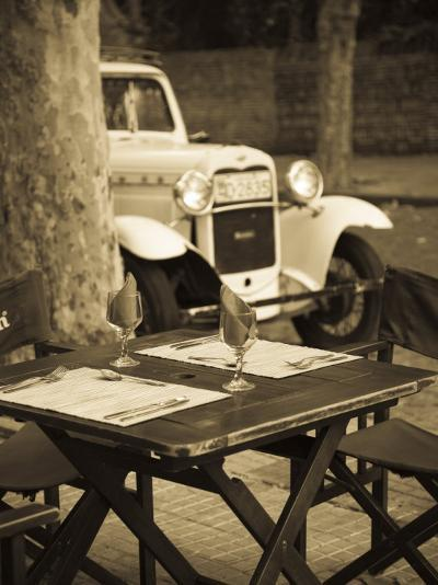 Colonia Del Sacramento, Cafe Table and Old Car, Uruguay-Walter Bibikow-Photographic Print