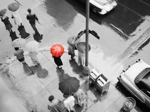 Color Pop,1950s AERIAL OF STREET CORNER IN THE RAIN PEDESTRIANS WITH UMBRELLAS CARS WET PAVEMENT