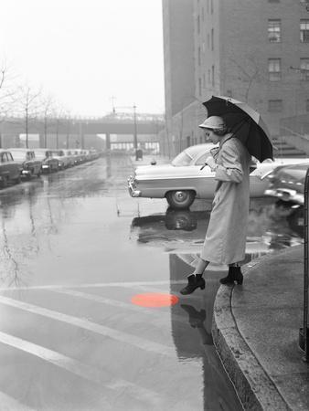 https://imgc.artprintimages.com/img/print/color-pop-1950s-woman-in-rain-coat-hat-boots-holding-umbrella-crossing-city-street_u-l-q1filux0.jpg?p=0