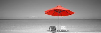 https://imgc.artprintimages.com/img/print/color-pop-chairs-under-an-umbrella-on-the-beach-turks-and-caicos-islands-north-atlantic-ocean_u-l-q1fimvx0.jpg?p=0