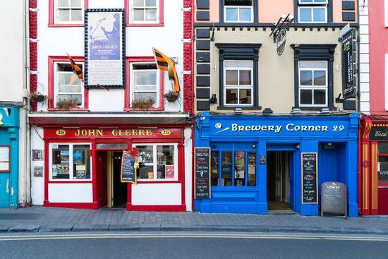 Colorful building fronts of traditional beer pubs in Kilkenny, County Kilkenny, Leinster, Ireland-Logan Brown-Photographic Print