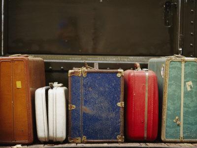https://imgc.artprintimages.com/img/print/colorful-but-worn-luggage-awaits-travelers-in-a-train-station_u-l-p3rtuq0.jpg?p=0