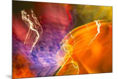 Colorful glass with blurred motion effect.-Stuart Westmorland-Mounted Photographic Print