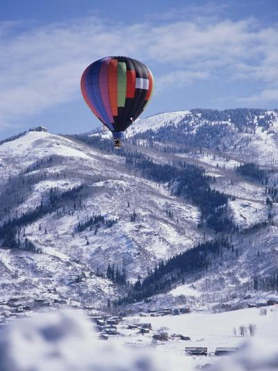 Colorful Hot Air Balloon Against Winter Landscape--Photographic Print