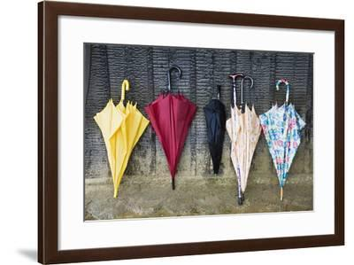 Colorful Umbrellas Leaning against a Wall-Nosnibor137-Framed Photographic Print