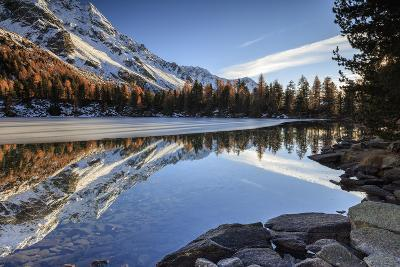 Colourful Woods are Reflected in Saoseo Lake Still Partially Frozen, Switzerland-Roberto Moiola-Photographic Print