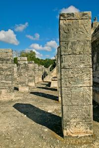 Columns with carved stonework on the Temple of the Warriors at the ancient Mayan city of Chichen...