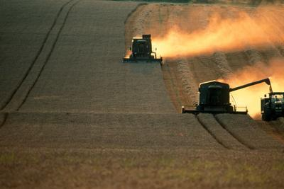 https://imgc.artprintimages.com/img/print/combine-harvesters-and-tractor-working-in-a-field_u-l-pzk6170.jpg?p=0