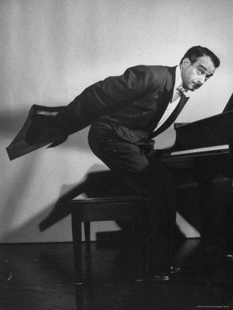 https://imgc.artprintimages.com/img/print/comedian-pianist-victor-borge-in-white-tie-and-tails-standing-at-piano-and-making-funny-faces_u-l-p477be0.jpg?p=0