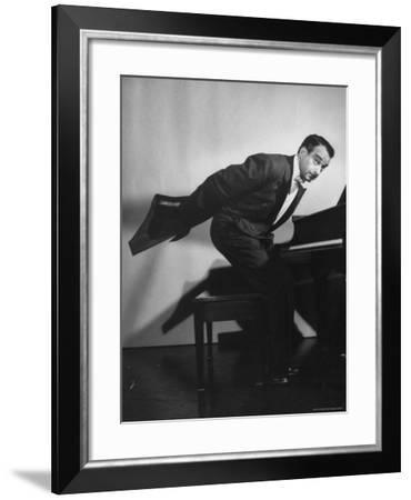 Comedian Pianist Victor Borge, in White Tie and Tails, Standing at Piano and Making Funny Faces-Peter Stackpole-Framed Premium Photographic Print
