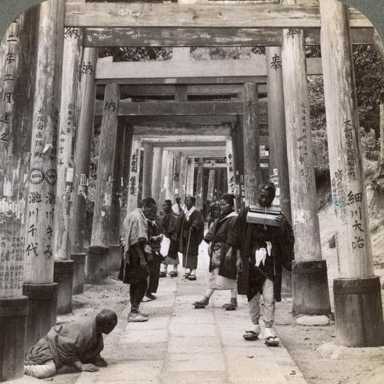 Coming and Going under Long Rows of Sacred Torii, Shinto Temple of Inari, Kyoto, Japan, 1904-Underwood & Underwood-Photographic Print