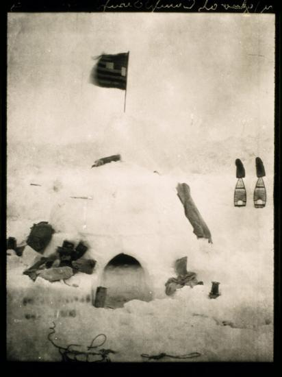 Commander Pearys Igloo is Marked by an American Flag on Top and Surrounded by Scattered Supplies-Robert Peary-Photographic Print
