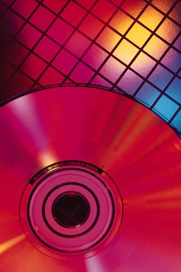 Compact Disc on Grid-Comstock-Photographic Print