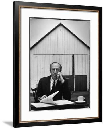Composer Arron Copland Sitting at Table with Score in Front of Barn-Gordon Parks-Framed Premium Photographic Print