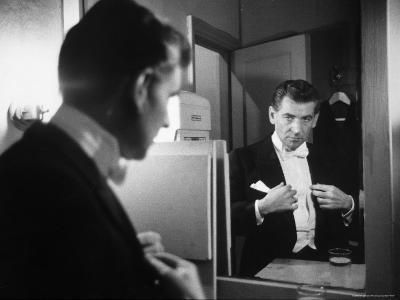 Composer/Conductor Leonard Bernstein Looking in Mirror before conducting Concert at Carnegie Hall-Alfred Eisenstaedt-Premium Photographic Print