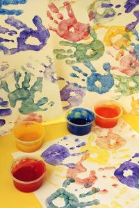 Colorful Handprints and Cups of Paint by Comstock