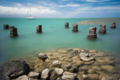 Concrete Pylons of an Old Wharf Stand Sentinel in the Turquoise Kalohi Channel-Jonathan Kingston-Photographic Print