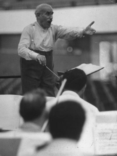 Conductor Arturo Toscanini, Singing and Shouting Instructions While Rehearsing His Men in a Gym-Joe Scherschel-Premium Photographic Print