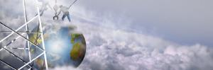 Construction Workers Attaching a Crane to Earth with Clouds