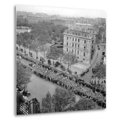 Contestants in the 1948 Tour De France Parade up the Champs Elysees