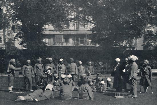 'Convalescent Indian Soldiers Playing Quoits on the Eastern Lawns', c1915, (1939)-Unknown-Photographic Print