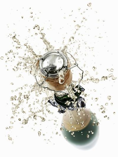Cork Flying Out of a Sparkling Wine Bottle-Kr?ger & Gross-Photographic Print